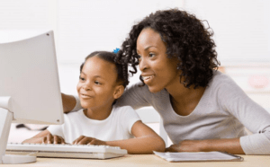 mother and daughter working on computer