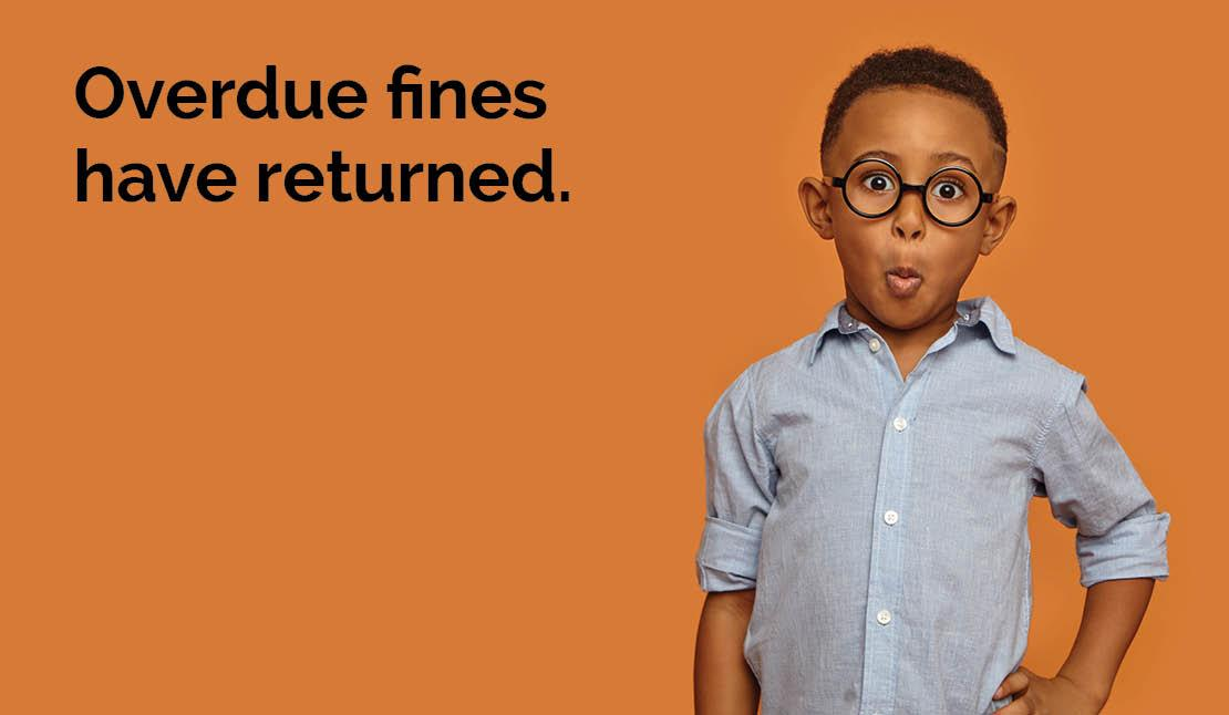 Overdue fines have returned. Photo of a boy looking surprised.